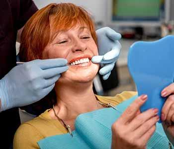 Dr. Bingham-Lester Vickii at Bingham-Lester Dentistry offers best dental health care maintenance for dentures.